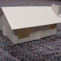 Dom z papieru z kominem