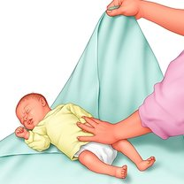zawijanie dziecka w kocyk - krok 1