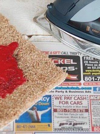 Jak usunąć plamy z wosku z dywanu